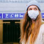 Woman wearing face mask at departure lounge